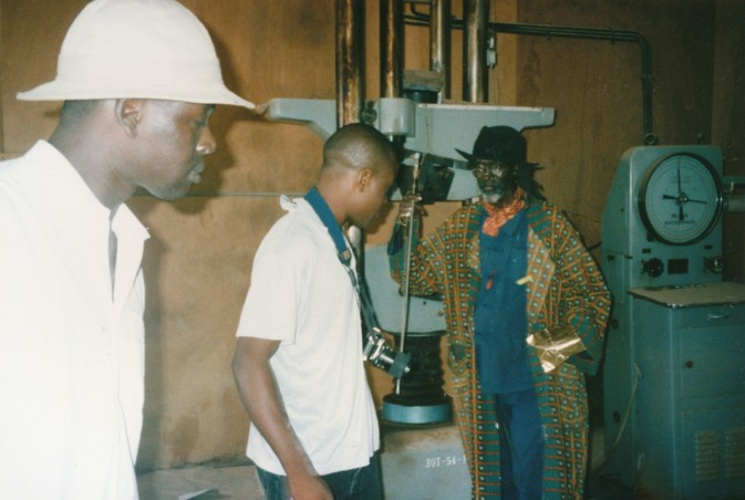 El Sy, Chika Okeke and Issa Samb visiting the brick-pressing plant. The Chinese laborers produced the bricks for the sports stadium, 1996. Photo: Clémentine Deliss