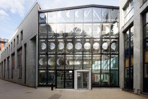 Yto Barrada Des trous dans la lune, 2020 Installation sur la façade de l'Ecole nationale supérieure d'arts Paris Cergy, dans le cadre d'un « Eté culturel en Île-de-France » DRAC / Ministère de la culture. Crédit photographique : George Dupin